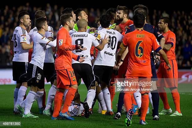 Gerard Pique of FC Barcelona argues with Valencia CF players after Nicolas Otamendi fault over Neymar JR during the La Liga match between Valencia CF...