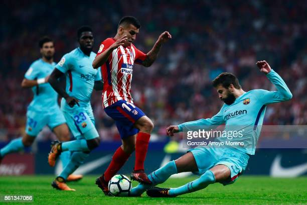 Gerard Pique of FC Barcelona blocks Angel Martin Correa of Atletico de Madrid during the La Liga match between Club Atletico Madrid and FC Barcelona...