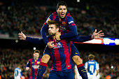 Gerard Pique of FC Barcelona celebrates with his teammate Luis Suarez after scoring his team's third goal during the La Liga match between FC...