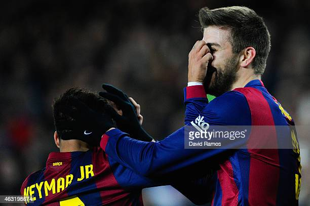 Gerard Pique of FC Barcelona celebrates with his teammate Neymar after scoring his team's third goal during the Copa del Rey SemiFinal first leg...