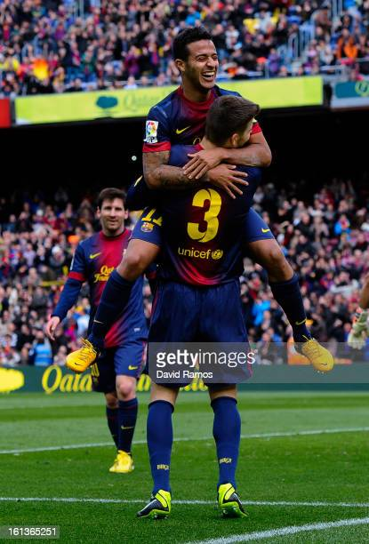 Gerard Pique of FC Barcelona celebrates with his teammate Thiago Alcantara after scoring his team's sixth goal during the La Liga match between FC...