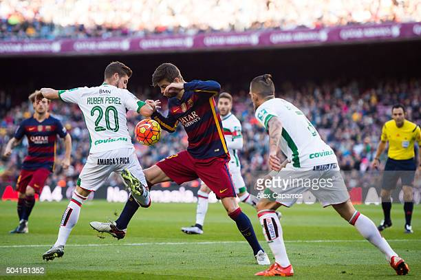 Gerard Pique of FC Barcelona competes for the ball with Ruben Perez and Cristiano Biraghi of Granada CF during the La Liga match between FC Barcelona...