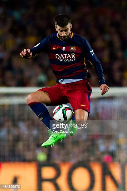 Gerard Pique of FC Barcelona controls the ball during the Spanish Super Cup second leg match between FC Barcelona and Athletic Club at Camp Nou on...