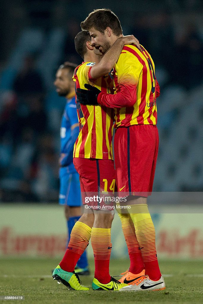 <a gi-track='captionPersonalityLinkClicked' href=/galleries/search?phrase=Gerard+Pique&family=editorial&specificpeople=227191 ng-click='$event.stopPropagation()'>Gerard Pique</a> (R) of FC Barcelona embraces his teammate Javier Alejandro Mascherano (L) during the La Liga match between Getafe CF and FC Barcelona at Coliseum Alfonso Perez on December 22, 2013 in Getafe, Spain.