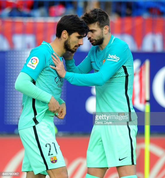 Gerard Pique of FC Barcelona has a word with teammate Andre Gomes after Lionel Messi scored Barcelona's 2nd goal during the La Liga match between...