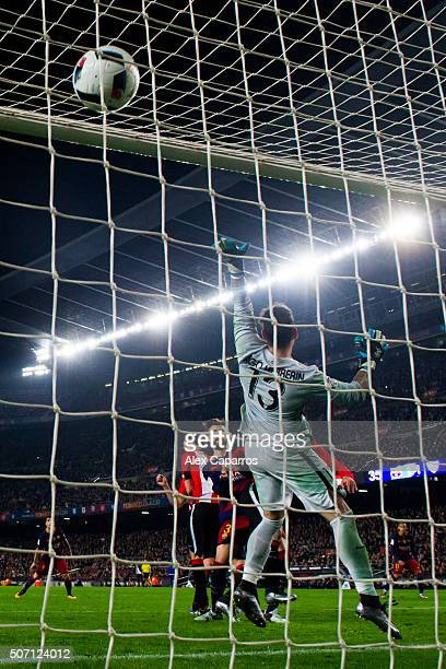 Gerard Pique of FC Barcelona heads the ball past goalkeeper Iago Herrerin of Athletic Club and scores his team's second goal during the Copa del Rey...