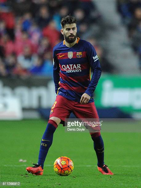 Gerard Pique of FC Barcelona in action during the La Liga match between Sporting Gijon and FC Barcelona at Estadio El Molinon on February 17 2016 in...