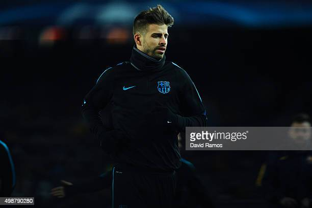 Gerard Pique of FC Barcelona in action during the warm up ahead of the UEFA Champions League Group E match between FC Barcelona and AS Roma at Camp...
