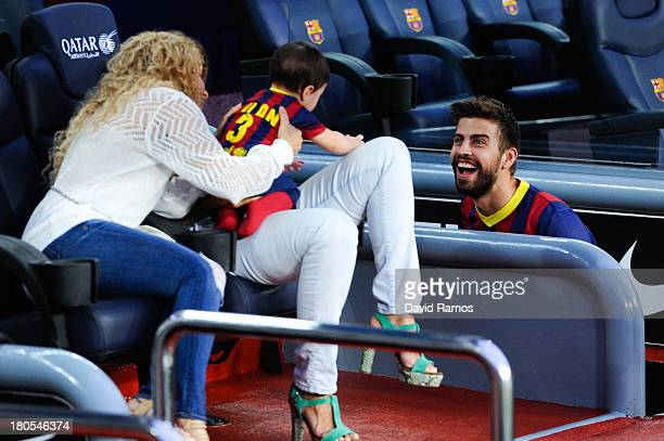 Gerard Pique of FC Barcelona jokes with his son Milan and his wife Shakira prior to the La Liga match between FC Barcelona and Sevilla FC at Camp Nou...