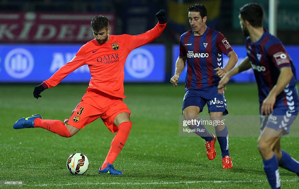 Gerard Pique of FC Barcelona kicks the ball during the La Liga match between SD Eibar and FC Barcelona at Ipurua Municipal Stadium on March 14, 2015 in Eibar, Spain.