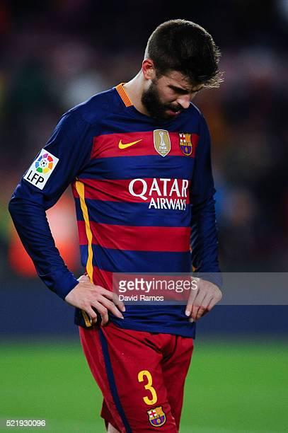 Gerard Pique of FC Barcelona leaves the pitch dejected at the end of the La Liga match between FC Barcelona and Valencia CF at Camp Nou on April 17...