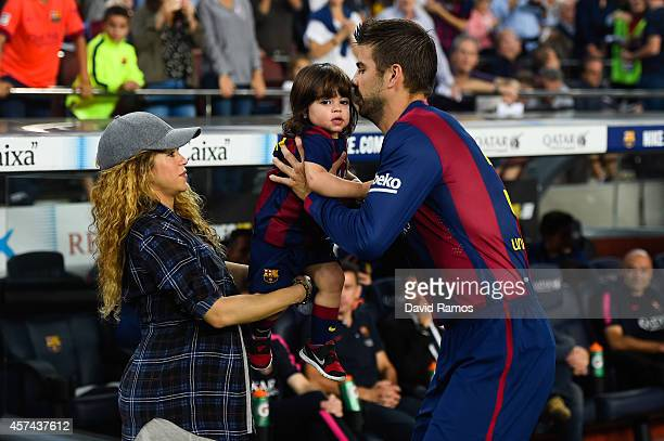 Gerard Pique of FC Barcelona passes his son Milan to his wife Shakira during the La Liga match between FC Barcelona and SD Eibar at Camp Nou on...