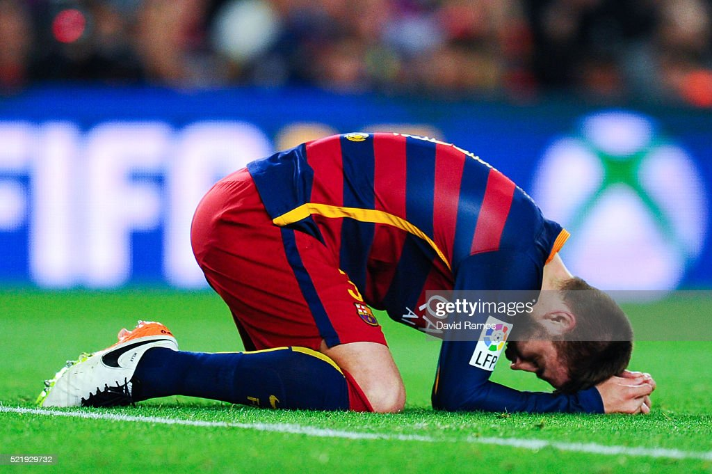 Gerard Pique of FC Barcelona reacts after missing a chance to score during the La Liga match between FC Barcelona and Valencia CF at Camp Nou on April 17, 2016 in Barcelona, Spain.