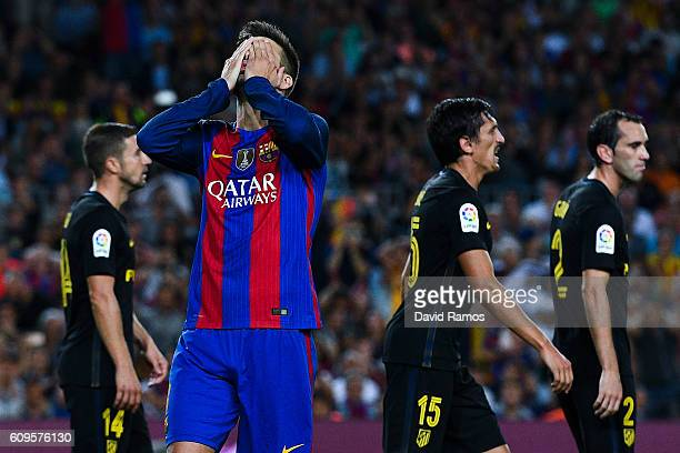 Gerard Pique of FC Barcelona reacts after missing a chance to score during the La Liga match between FC Barcelona and Club Atletico de Madrid at the...