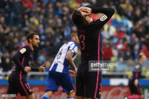 Gerard Pique of FC Barcelona reacts after missing a goal opportunity during the La Liga match between RC Deportivo La Coruna and FC Barcelona at...