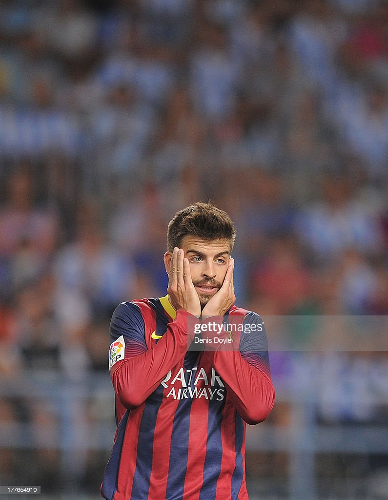 Gerard Pique of FC Barcelona reacts during the La Liga match between Malaga CF and FC Barcelona at La Rosaleda Stadium on August 25, 2013 in Malaga, Spain.