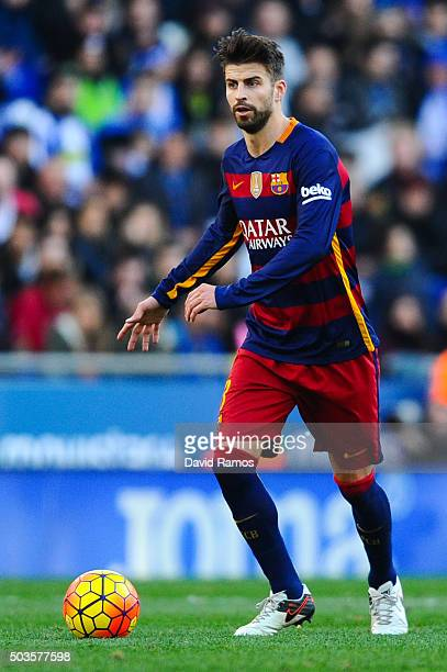 Gerard Pique of FC Barcelona runs with the ball during the La Liga match between RCD Espanyol and FC Barcelona at CornellaEl Prat Stadium on January...