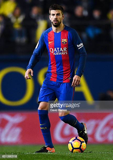 Gerard Pique of FC Barcelona runs with the ball during the La Liga match between Villarreal CF and FC Barcelona at Estadio de la Ceramica stadium on...