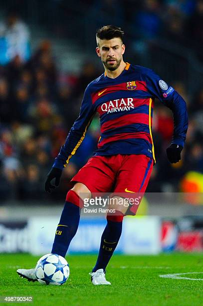 Gerard Pique of FC Barcelona runs with the ball during the UEFA Champions League Group E match between FC Barcelona and AS Roma at Camp Nou stadium...