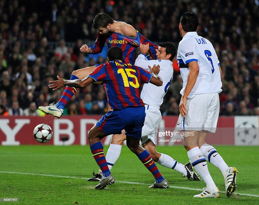 <a gi-track='captionPersonalityLinkClicked' href=/galleries/search?phrase=Gerard+Pique&family=editorial&specificpeople=227191 ng-click='$event.stopPropagation()'>Gerard Pique</a> (2nd L) of FC Barcelona scores his side's opening goal past <a gi-track='captionPersonalityLinkClicked' href=/galleries/search?phrase=Thiago+Motta&family=editorial&specificpeople=631059 ng-click='$event.stopPropagation()'>Thiago Motta</a> (2nd R) of Inter Milan as <a gi-track='captionPersonalityLinkClicked' href=/galleries/search?phrase=Seydou+Keita&family=editorial&specificpeople=709847 ng-click='$event.stopPropagation()'>Seydou Keita</a> (L) of FC Barcelona and Lucio of Inter Milan look on during the UEFA Champions League group F match between FC Barcelona and Inter Milan at the Camp Nou Stadium on November 24, 2009 in Barcelona, Spain.
