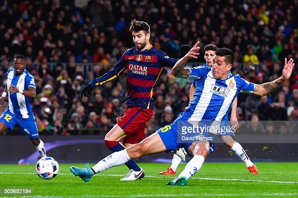 Gerard Pique of FC Barcelona scores his team's third goal during the Copa del Rey Round of 16 first leg match between FC Barcelona and RCD Espanyol...