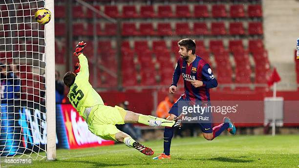 Gerard Pique of FC Barcelona scores the first goal during the Catalunya Supercup Final at Montilivi Stadium on October 29 2014 in Girona Spain