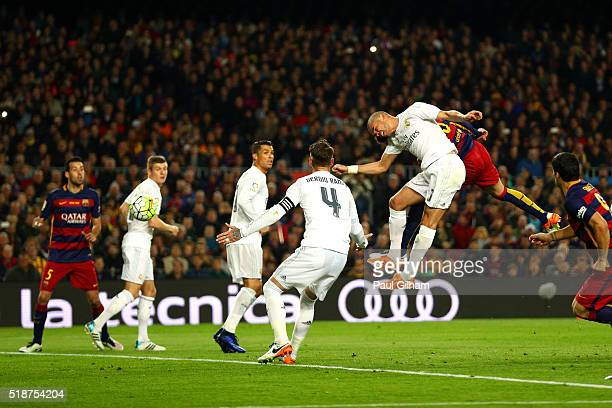 Gerard Pique of FC Barcelona scores the opening goal during the La Liga match between FC Barcelona and Real Madrid CF at Camp Nou on April 2 2016 in...