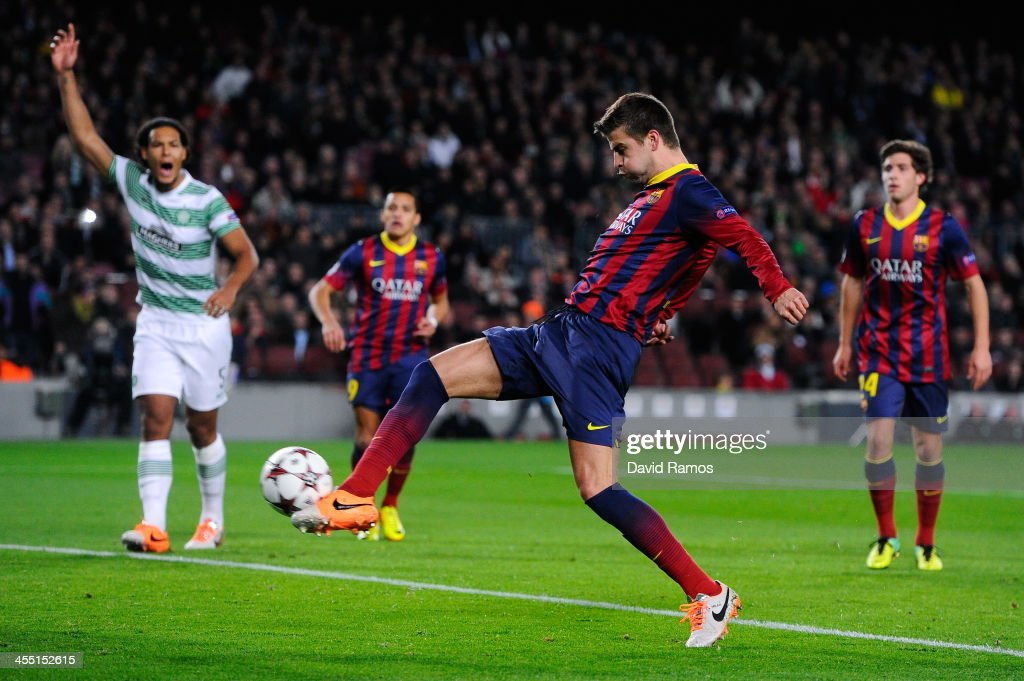 <a gi-track='captionPersonalityLinkClicked' href=/galleries/search?phrase=Gerard+Pique&family=editorial&specificpeople=227191 ng-click='$event.stopPropagation()'>Gerard Pique</a> of FC Barcelona scores the opening goal during the UEFA Champions League Group H match between FC Barcelona and Celtic FC at Camp Nou on December 11, 2013 in Barcelona, Spain.
