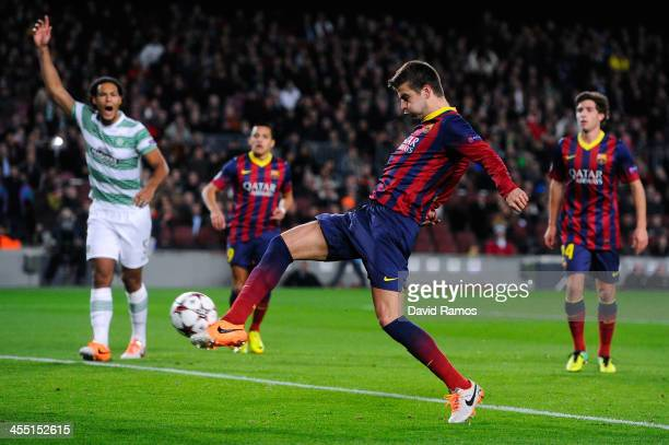 Gerard Pique of FC Barcelona scores the opening goal during the UEFA Champions League Group H match between FC Barcelona and Celtic FC at Camp Nou on...