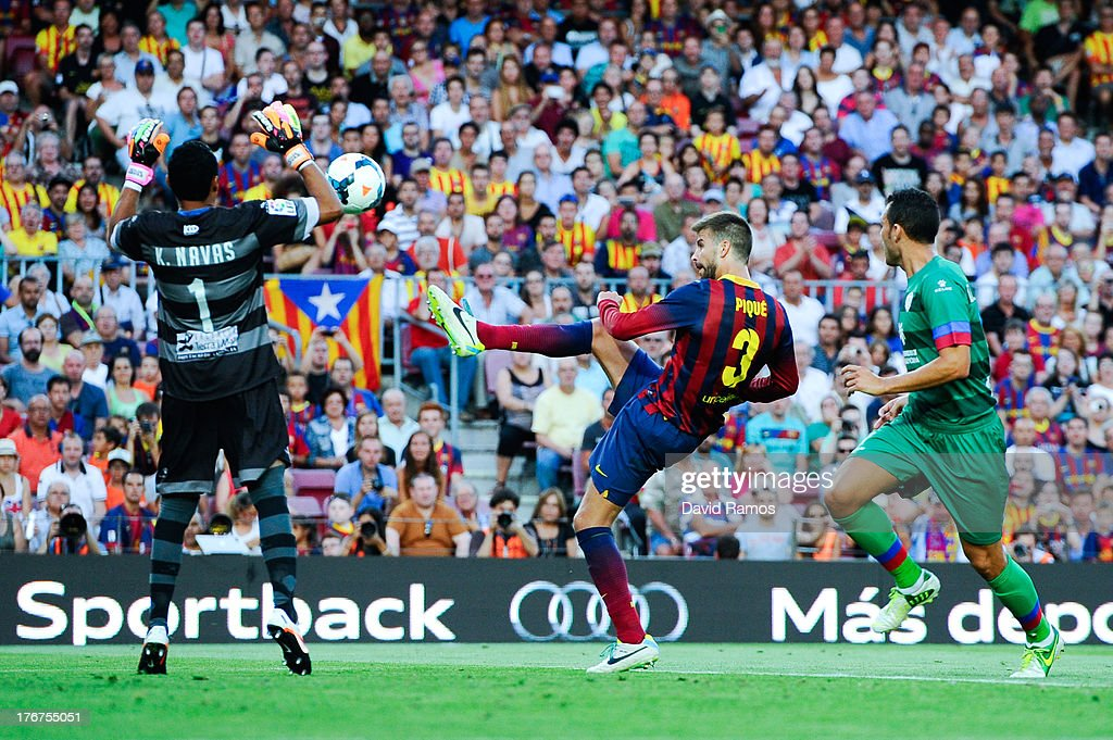 <a gi-track='captionPersonalityLinkClicked' href=/galleries/search?phrase=Gerard+Pique&family=editorial&specificpeople=227191 ng-click='$event.stopPropagation()'>Gerard Pique</a> of FC Barcelona shoots towards goal under a challenge by <a gi-track='captionPersonalityLinkClicked' href=/galleries/search?phrase=Keylor+Navas&family=editorial&specificpeople=2097517 ng-click='$event.stopPropagation()'>Keylor Navas</a> Gamboa of Levante UD (L) during the La Liga match between FC Barcelona and Levante UD at Camp Nou on August 18, 2013 in Barcelona, Spain.