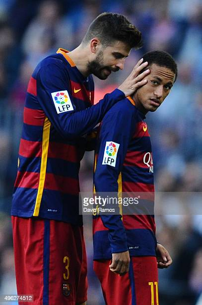 Gerard Pique of FC Barcelona talks to his team mate Neymar of FC Barcelona after being shown a yellow card by the referee Clos Gomez during the La...
