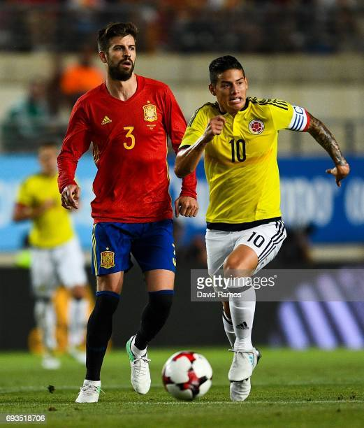 Gerard Pique of Spain and James Rodriguez of Colombia compete for the ball during a friendly match between Spain and Colombia at La Nueva Condomina...