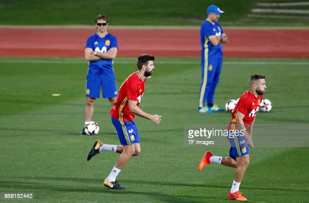 Gerard Pique of Spain and Jordi Alba of Spain and Head coach Julen Lopetegui of Spain attends a training session on October 2 2017 in Madrid Spain
