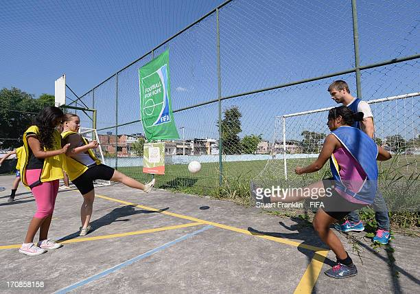 Gerard Pique of Spain attends the Football for Hope project Vencer Programme of Comanheiros das Americas on June 19 2013 in Rio de Janeiro Brazil