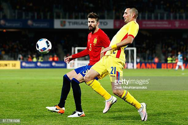 Gerard Pique of Spain battles for the ball with Dragos Grigore of Romania during the International Friendly match between Romania and Spain held at...
