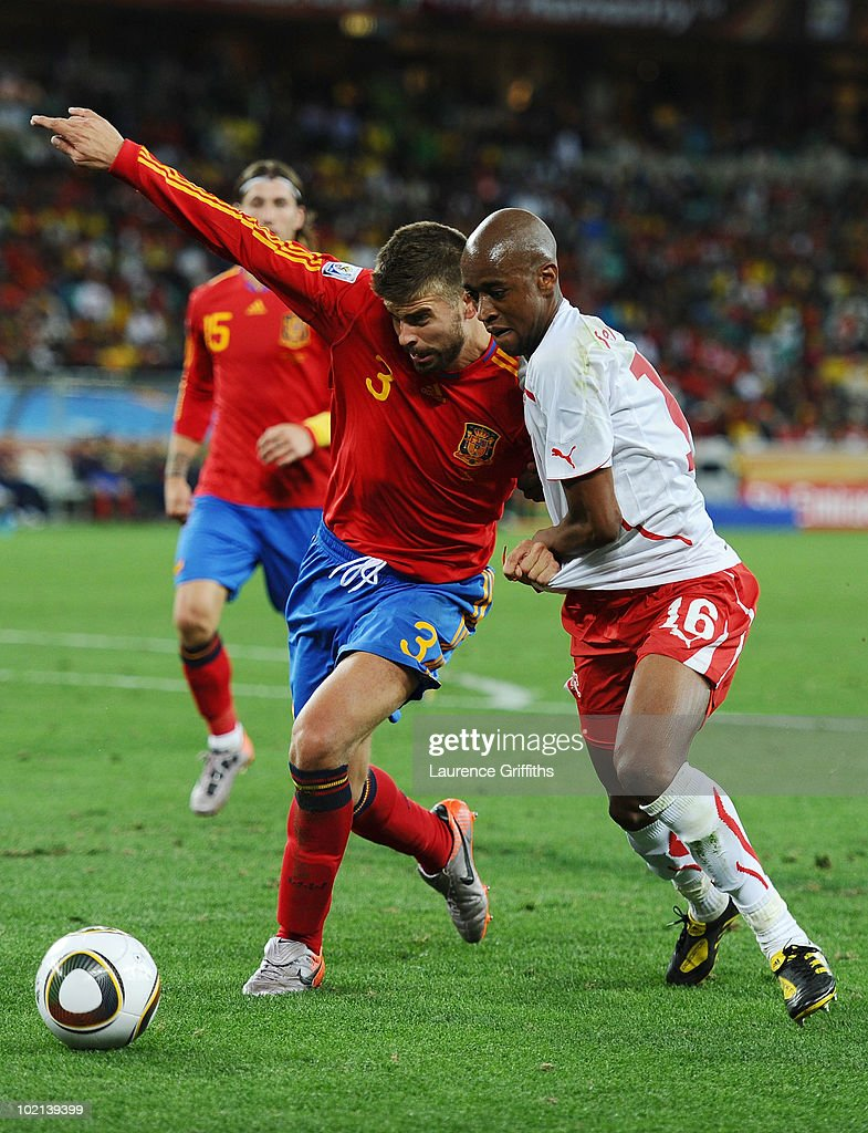 <a gi-track='captionPersonalityLinkClicked' href=/galleries/search?phrase=Gerard+Pique&family=editorial&specificpeople=227191 ng-click='$event.stopPropagation()'>Gerard Pique</a> of Spain clashes with <a gi-track='captionPersonalityLinkClicked' href=/galleries/search?phrase=Gelson+Fernandes&family=editorial&specificpeople=2971817 ng-click='$event.stopPropagation()'>Gelson Fernandes</a> of Switzerland during the 2010 FIFA World Cup South Africa Group H match between Spain and Switzerland at Durban Stadium on June 16, 2010 in Durban, South Africa.