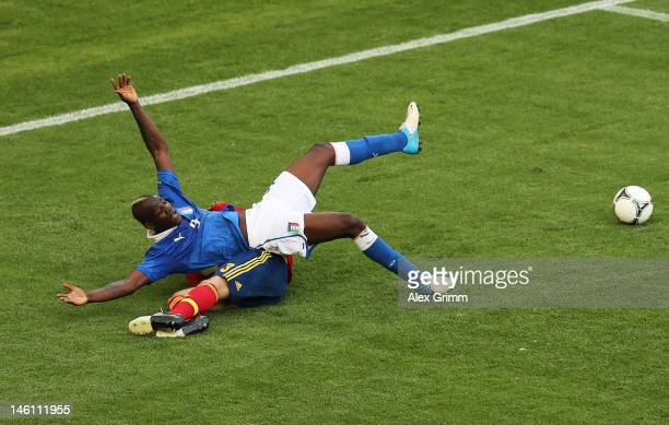 Gerard Pique of Spain clashes with Mario Balotelli of Italy during the UEFA EURO 2012 group C match between Spain and Italy at The Municipal Stadium...