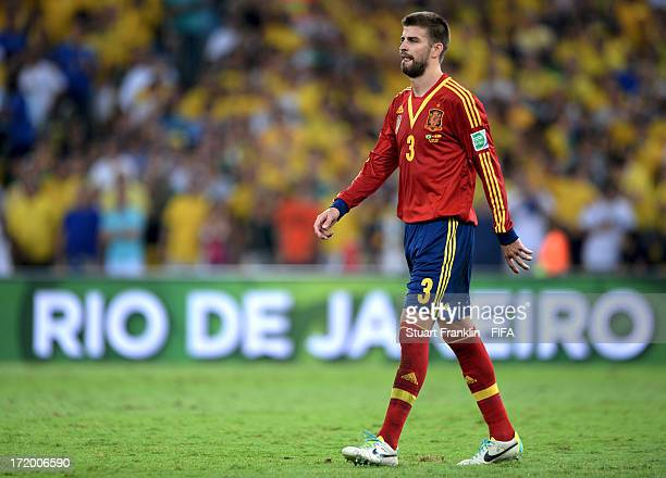 Gerard Pique of Spain heads for the dressing room after being sent off for a tackle on Neymar of Brazil during the FIFA Confederations Cup Brazil...