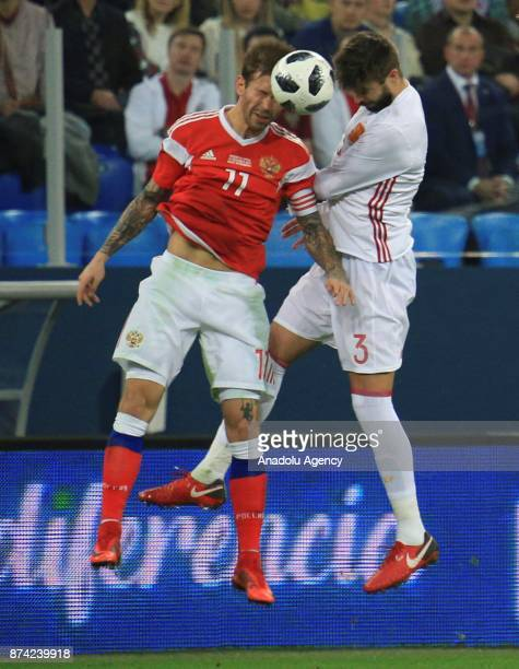 Gerard Pique of Spain in action against Fedor Smolov of Russia during an international friendly football match between Russia and Spain at...