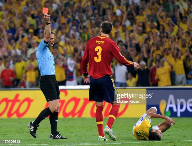 Gerard Pique of Spain is shown a red card by Referee Bjorn Kuipers for a tackle on Neymar of Brazil during the FIFA Confederations Cup Brazil 2013...