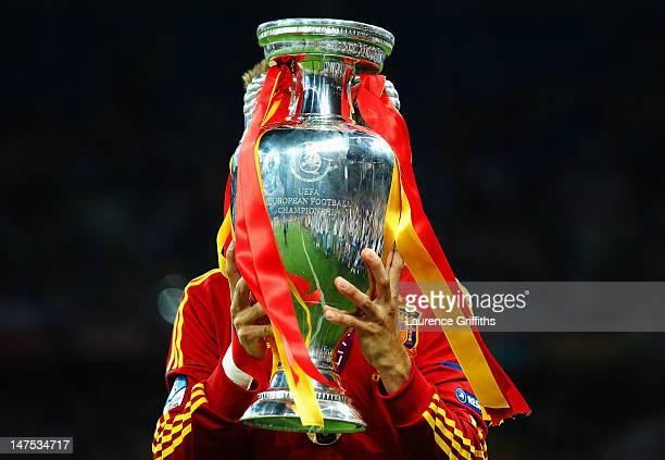 Gerard Pique of Spain kisses the trophy following victory in the UEFA EURO 2012 final match between Spain and Italy at the Olympic Stadium on July 1...