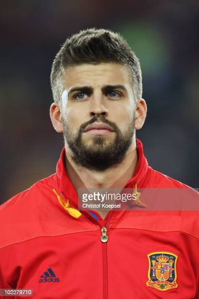 Gerard Pique of Spain lines up for the national anthems prior to the 2010 FIFA World Cup South Africa Group H match between Spain and Honduras at...