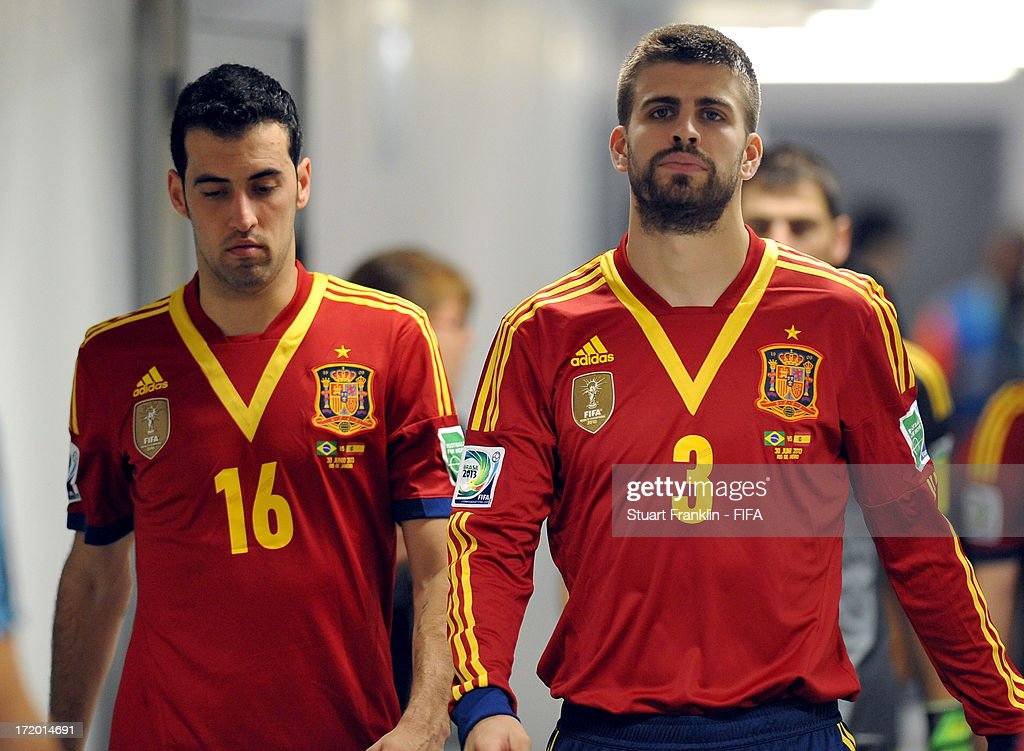 <a gi-track='captionPersonalityLinkClicked' href=/galleries/search?phrase=Gerard+Pique&family=editorial&specificpeople=227191 ng-click='$event.stopPropagation()'>Gerard Pique</a> of Spain (R) looks on during the FIFA Confederations Cup Brazil 2013 Final match between Brazil and Spain at Maracana on June 30, 2013 in Rio de Janeiro, Brazil.