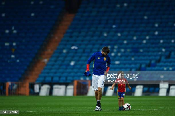 Gerard Pique of Spain plays with his son Milan Pique after the FIFA 2018 World Cup Qualifier between Spain and Italy at Estadio Santiago Bernabeu on...
