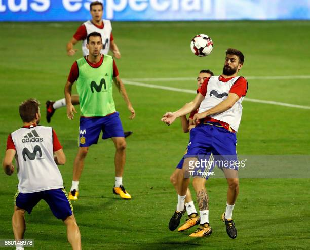Gerard Pique of Spain Sergio Busquets of Spain and Iago Aspas of Spain attends a training session on October 5 2017 in Alicante Spain