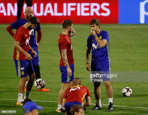 Gerard Pique of Spain Sergio Ramos of Spain and Head coach Julen Lopetegui of Spain attends a training session on October 5 2017 in Alicante Spain