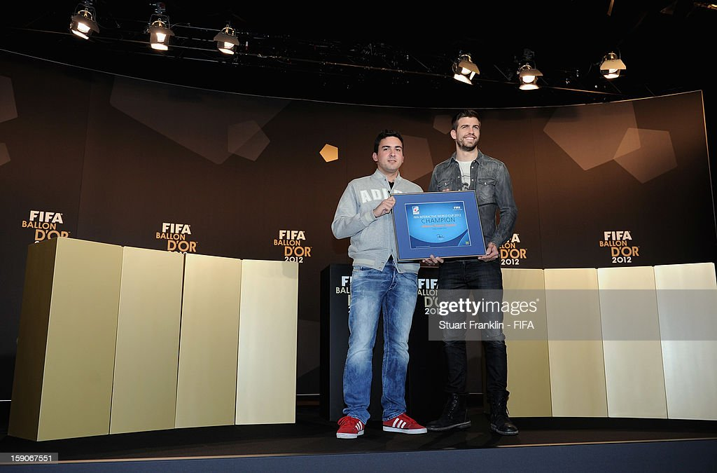 Gerard Pique presents the FIFA Interactive World Cup 2012 award to Alfonso Ramos of Spain prior to the FIFA Ballon d'Or Gala 2012 at the Kongresshaus on January 7, 2013 in Zurich, Switzerland.