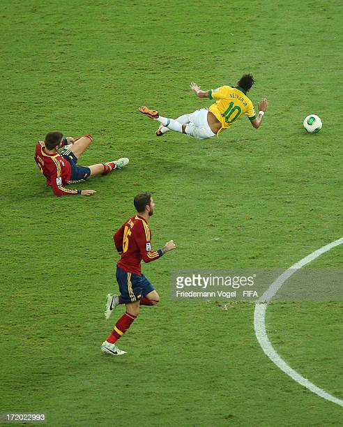 Gerard Pique tackles Neymar of Brazil and is subsequently sent off during the FIFA Confederations Cup Brazil 2013 Final match between Brazil and...