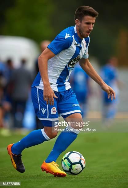 Gerard Valentin of Deportivo de La Coruna runs with the ball during the preseason friendly match between Cerceda and Deportivo de La Coruna at O Roxo...