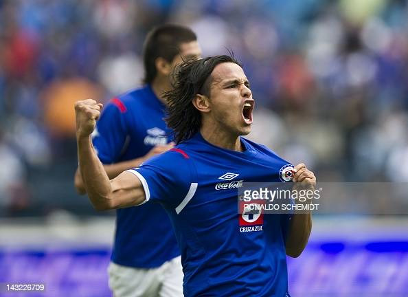 Gerarddo Flores of Cruz Azul celebrates his goal against Estudiantes during their Mexican Clausura tournament in Mexico City on April 21 2012 AFP...